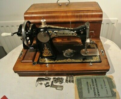 Antique Frister & Rossmann Handcrank Sewing machine with attachments & Manual