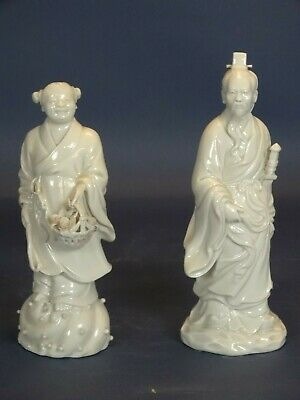 Pair of white Chinese porcelain sculptures Daoguang XIX Mandarin and servant