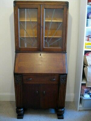Wooden writing bureau and bookcase with drop-down writing desk.
