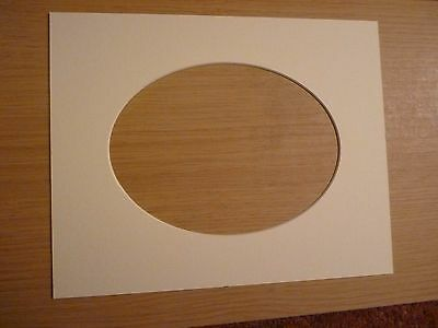 """Textured white Photo mount. Oval aperture  for 7"""" x 5"""" photo"""