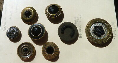 7 BLACK GLASS IN METAL and 1 fabric pad back w bg crescent antique buttons