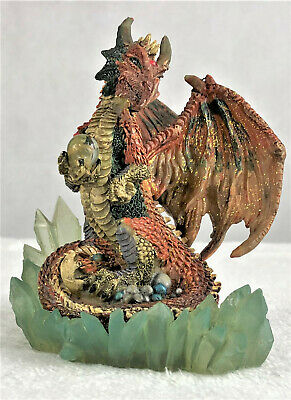 Orange Dragon with Gold Sparkle Holding Crystal Ball on Bed of Lookalike Crystal