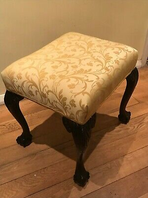 A 19th century mahogany stool with ball and claw feet, newly upholstered