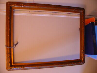 A Large Antique Hand Carved Arts and Crafts Picture Frame