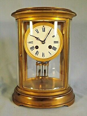 "19c French Gilt Bronze Oval 4 Glass Clock ""Vincenti""."