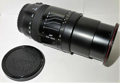 Tokina AF 35-300mm f/4.5-6.7 Zoom Lens for Canon EF Mount w Caps/ Skylight 1A