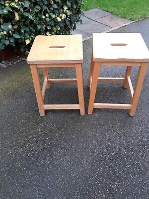 A pair of vintage school stools