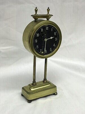 Interesting antique brass mystery clock, British made. 10.5 inches high
