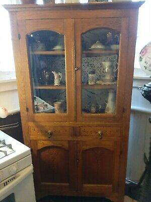 Antique Spoon Carved China Cabinet