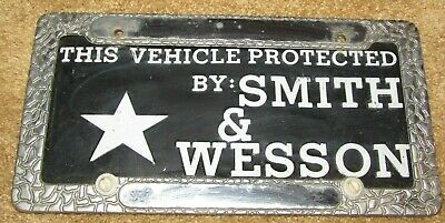"""Rare Vintage License Plate """"Protected By Smith & Wesson"""" W/Metal License Frame"""