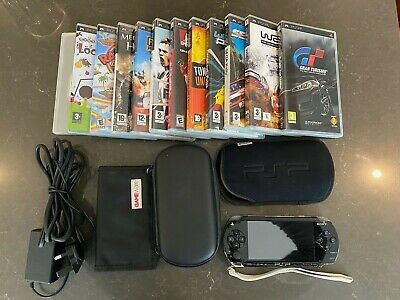 Sony PSP Console. Very Good Original Condition. 12 games & Various Carry Cases.