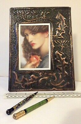 Striking Arts and Crafts movement hammered copper picture frame.