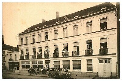 Antique printed postcard street scene with figures car & the Hotel Cosyn