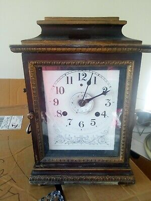 john bull antique mantel clock seven day . good working order with key