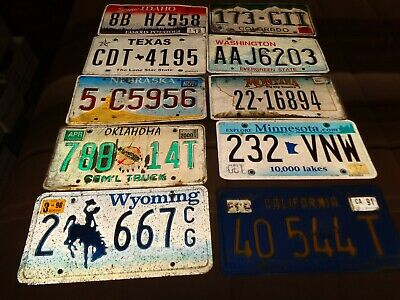 LOT OF ELEVEN (11) DIFFERENT VINTAGE USA license plates (OVER THREE YEARS OLD)