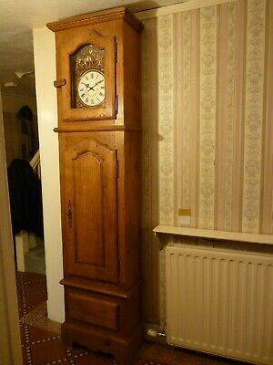 Modern grandfather clock made possibly from oak and distressed to make authentic