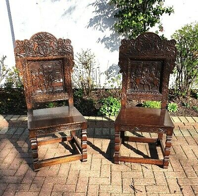 Superb pair of Victorian Carved Oak Hall / Side chairs with Royal carved scenes