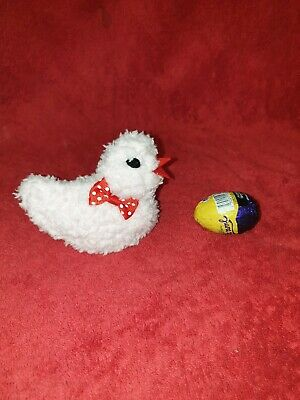 Hand knitted Easter chick egg cosy to cover a creme egg. Red polka dot bow