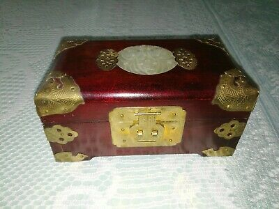 Oriental style wooden musical jewelry box with brass and jade  features.