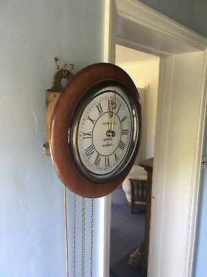 Antique Clock. Postmans Wall Clock. Wag On the wall. In Good Working Order.