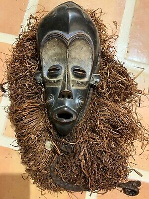 "Antique African art hand carved wood mask raffia hair big brown eyes 20"" overall"