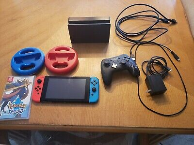 Nintendo Switch HAC-001 32GB Console with Neon joycons, Pokemon, and accessories