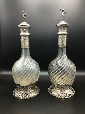 A Pair of Antique German Silver mounted Claret Jugs / Decanters