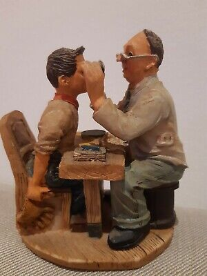 Vintage Figurine Boy at The Optician