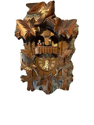 Vintage Oak One Day Cuckoo Clock Musical with revolving Carousel