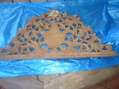 a very beautiful carving off very old mantle piece the timber is northern cedar
