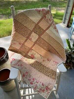 Girls nursery crib quilt with soft pink floral quality fabrics. Handmade
