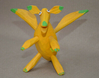 Handcrafted and painted yellow dragon with wings and an open mouth