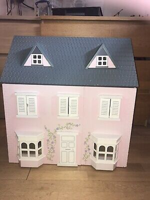 3 storey Pink wooden dolls house with furniture, wooden people & Accessories