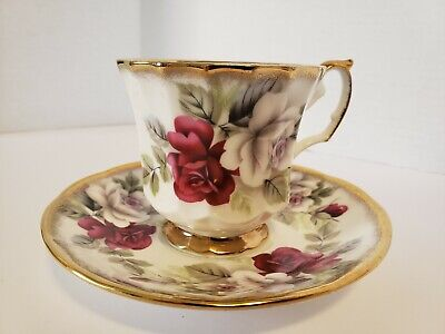 Elizabethan Stafforshire Hand decorated Jacobean Tea Cup And Saucer Roses