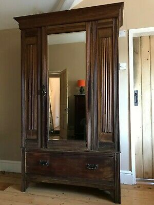 Antique Edwardian Walnut Wardrobe With Linen fold Panels And Bevelled Mirror