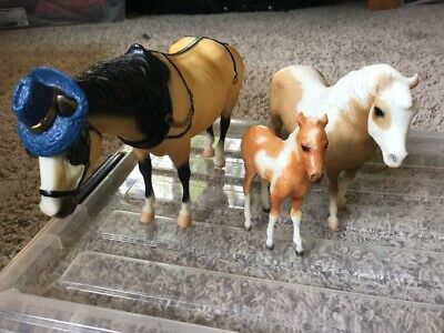 Assorted Breyer horses and acessories