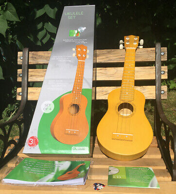 Ukulele Set Includes Pick, Instruction Book and CD New In Box.