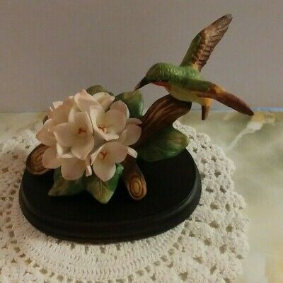 Vintage ** Hummingbird  ** Figurine with Flowers on Wooden Stand