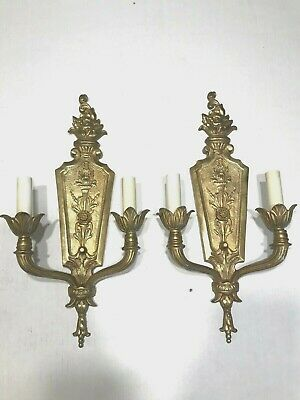 antique vintage handsome and very heavy  cast brass sconces, take crystals.