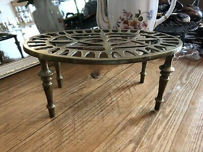 Antique Solid Brass Oval Shaped 4 Legged Fireside Trivet With Ornate Cut Out Top