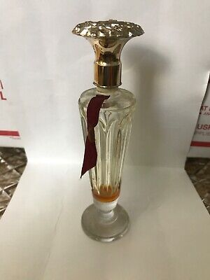 """Vintage perfume bottle with """"M"""" on cap"""
