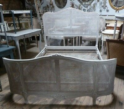 Louis XV style worn grey painted antique French bed with cane panels