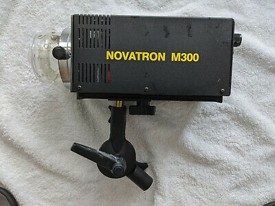 Novatron M300 Mono light; DOES NOT INCLUDE UMBRELLAS with mounting plate