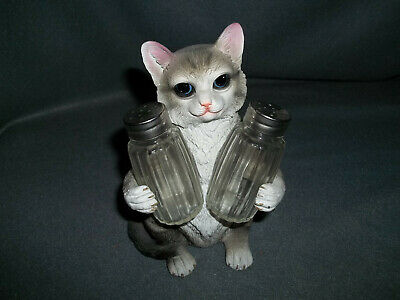 Dwk Cat Holding Salt And Pepper Shakers