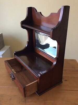 Antique mahogany wall mirror or table top mirror with draw and shelving.