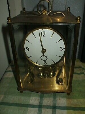 Kundo;  Vintage Clock; requires new spring fitting. not working. Collection.