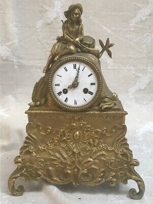 ANTIQUE FRENCH BRASS MANTEL CLOCK WITH SEATED HUNTER c1900