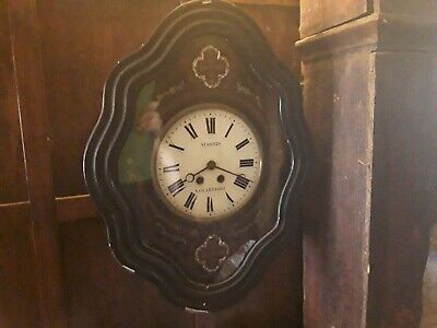 French oeil-de-boeuf antique 19th century wall clock with mother-of-pearl inlays