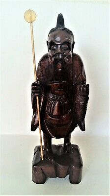 hand carved wooden asian monk figure