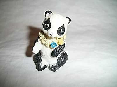 """Porcelain Panda Bear wearing lei with yellow and blue flower  1 7/8"""" tall"""